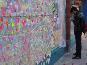 Message being written on post-riot board, Peckham